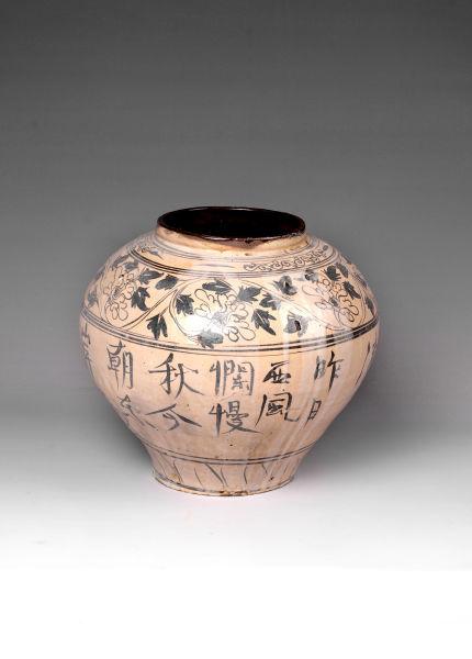 白釉褐彩题字罐的雅与俗